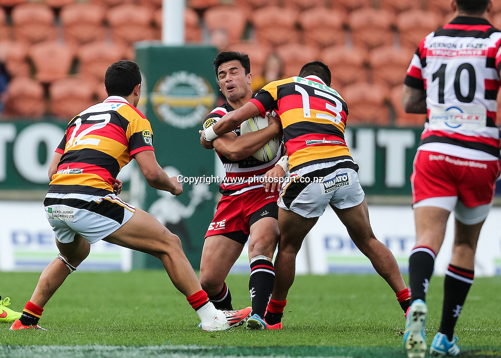Counties Maunkau's Sherwin Stowers  is hit in a big tackle from Waikato's Jordan Payne during the ITM Cup rugby match - Waikato v Counties Manukau at Waikato Stadium, Hamilton on Sunday 14 September 2014.  Photo: Bruce Lim / www.photosport.co.nz