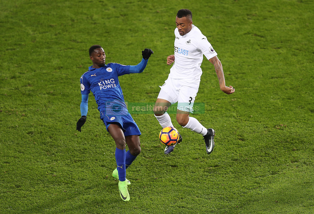 Swansea City's Jordan Ayew and Leicester City's Wilfred Ndidi