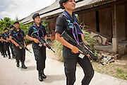 Sept. 29, 2009 -- BAAN TROKBON, THAILAND: Thai women rangers patrol a Buddhist village near their base. The 39 women in the 44th Army Ranger Regiment are the only Thai women seeing front line active duty against Moslem insurgents in Thailand's deep south provinces of Pattani, Narathiwat and Yala. All of the other women serving in Thai security services are employed as office and clerical workers. The Ranger women are based at the Ranger camp in the Buddhist village of Baan Trokbon in Sai Buri district of Pattani province. The unit was formed in 2006 after Muslims complained about the way Thai soldiers, all men, treated Muslim women at roadblocks and during security sweeps. The women are frequently called upon to back up Thai regular army units when they are expected to encounter a large number of Muslim women. At least two of the women have been killed by Muslim insurgents. The unit has both Muslim and Buddhist members. Many of the women in the unit joined after either their fathers or husbands were killed by insurgents.    Photo by Jack Kurtz / ZUMA Press