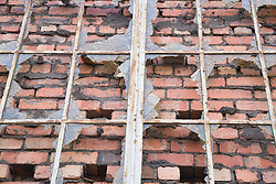 Close up of vandalised bricked up windows in a factory at Bootle; Liverpool; England,
