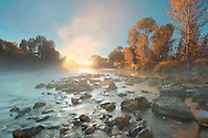 Idaho. Boise River with fall colors at sunrise.
