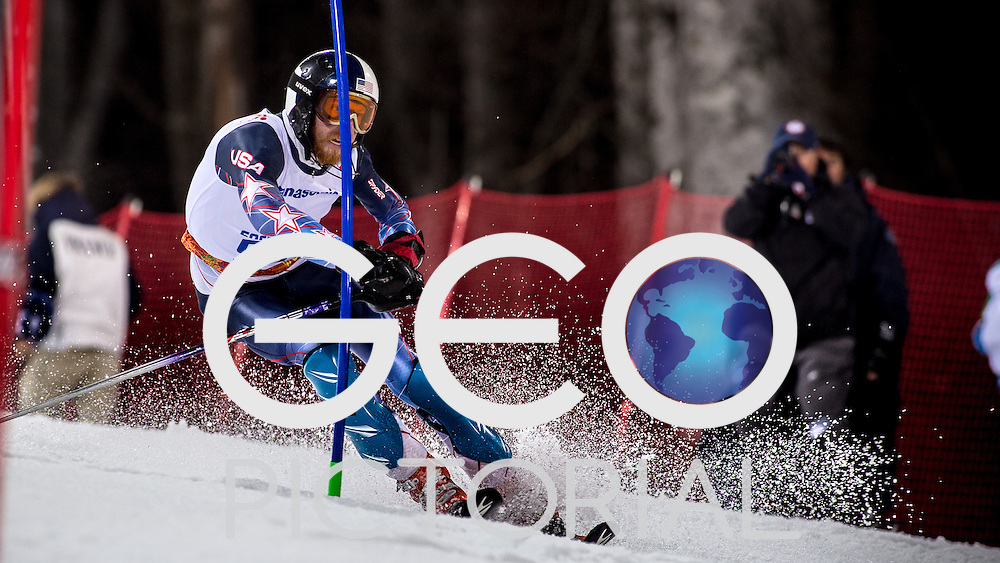 Alpine Skiing: Giant Slalom: 2014 Sochi Winter Paralympics: Ian Jansing of the USA in action on his second run during the floodlit evening session of the Men's Slalom Standing at Rosa Khutor Alpine Centre; Krasnaya Polyana, Russia 13/03/2014;<br /> PHOTO CREDIT: George S Blonsky