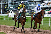 Just Cause and jockey Jack Andrews (yellow and black) and Champagne West with jockey Lilly Pinchin head to the start for the 4.05PM The Randox Health Foxhunters' Steeple Chase (Class 2) 2m 5f during the Grand National Festival Week at Aintree, Liverpool, United Kingdom on 4 April 2019.
