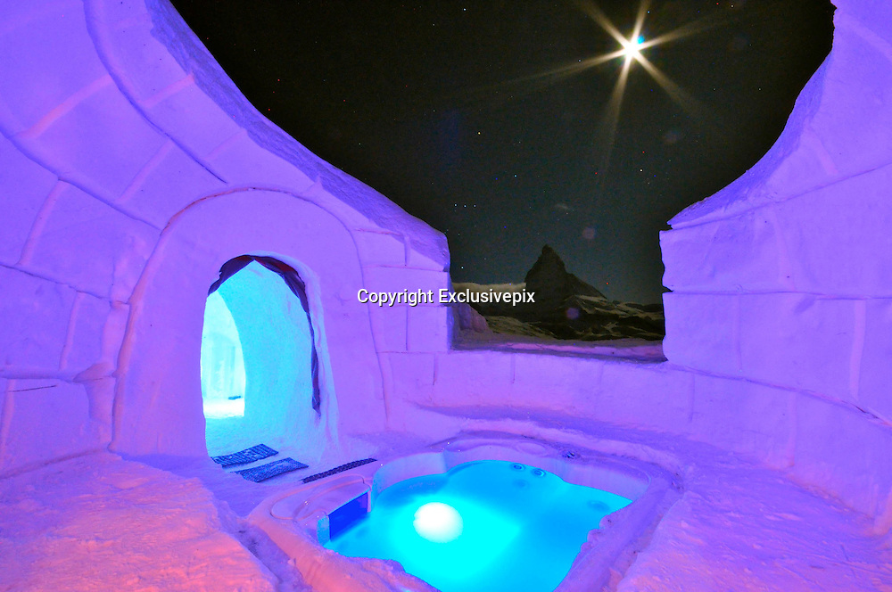Check in, chill out! Stunning igloo hotel opens with private pools, mountain saunas and candle-lit suites ... but no running water<br /> <br /> Every winter, this hotel is carved out of the surrounding snow, with igloo rooms, romantic suites and even an outdoor whirlpool for the bravest guests.<br /> <br /> Iglu-Dorf hotel is rebuilt every season from 3,000 tons of snow at six locations from the Alps to the Pyrenees.<br /> <br /> The Swiss igloos, constructed in the Bernese Oberland and surrounded by 9,000ft mountain peaks, comes with artworks carved into the walls by artists from around the world, candle-lit suites for romantic guests and even saunas among the mountains.<br /> Open from Christmas Day to April, each villages sleeps up to 38 guests, cocooning them in cosy sleeping bags on thick sheepskin rugs, designed to withstand temperatures of minus 40C.<br /> <br /> And in the morning, there's an enormous buffet of croissants, cooked meats, pastries, cereals, cheese and coffee.<br /> <br /> The cost for one in a standard Iglu-Dorf igloo is 99euros (£68) from Monday to Thursday and 115 euros from Friday to Sunday.<br /> <br /> A tour around the Gstaad site shows the great diversity of works in rooms and common areas of the unique accommodation from traditional Inuit works to artists from Switzerland and much further abroad.  <br /> <br /> Artists armed with no more than an ice pick, motorised saw and shovel, produce life-like animals such as seals, arctic wolves, polar bears and whales, eye-catching designs and patterns, or even super heroes. <br /> <br /> It's an elaborate and classy scene compared to the basic igloo Gunter first constructed with friends on a mountain in a bid to be first on the slopes in the morning.  <br /> <br /> The company says 99 per cent of their guests stay one night only. <br /> <br /> 'We don't generally recommend [more than one night] as we neither have running water, nor showers,' the company says.  <br /> <br /> Each village caters for 38 guests a night, all of who bed down on a thick sheepskin rug in cosy sleeping bags equipped for minus-40 degrees celsius. <br /> <br /> Nigh
