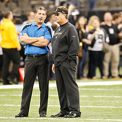 December 4, 2011; New Orleans, LA, USA; Detroit Lions head coach Jim Schwartz and New Orleans Saints defensive coordinator Gregg Williams talk prior to kickoff of a game at the Mercedes-Benz Superdome. Mandatory Credit: Derick E. Hingle-US PRESSWIRE