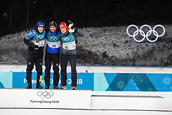 February 12, 2018 - Pyeongchang, SOUTH KOREA - 180212  Sebastian Samuelsson of Sweden, Silver, Martin Fourcae of France, Gold,  and Benedikt Doll of Germany, Bronze, celebrates on the podium after in the Men's Biathlon 12,5km Pursuit during day three of the 2018 Winter Olympics on February 12, 2018 in Pyeongchang..Photo: Jon Olav Nesvold / BILDBYRN / kod JE / 160157 (Credit Image: © Jon Olav Nesvold/Bildbyran via ZUMA Press)