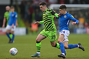 Forest Green Rovers Jack Aitchison(29), on loan from Celtic fends off Macclesfield Town's Connor Kirby(14) during the EFL Sky Bet League 2 match between Forest Green Rovers and Macclesfield Town at the New Lawn, Forest Green, United Kingdom on 29 December 2019.