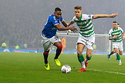 Alfredo Morelos of Rangers FC & Kristoffer Ajer of Celtic FC chase a loose ball during the Betfred Scottish League Cup Final match between Rangers and Celtic at Hampden Park, Glasgow, United Kingdom on 8 December 2019.