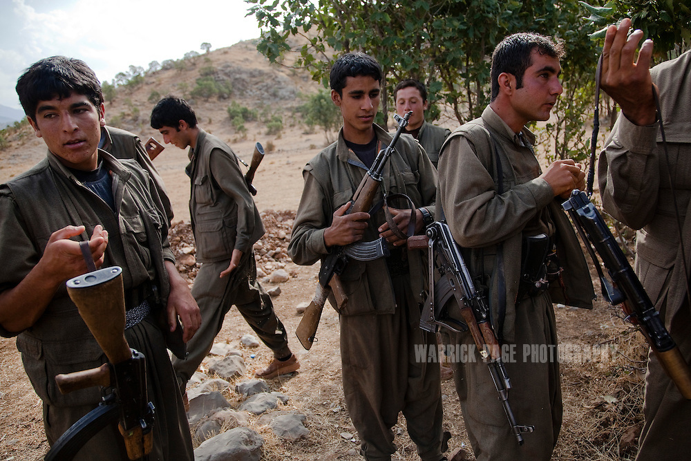 QANDIL MOUNTAINS, IRAQI KURDISTAN - SEPTEMBER 19: PKK (Kurdish Worker's Party) soldiers prepare to head back to their outpost after a training exercise, on September 19, 2010, in the Qandil Mountains, Iraqi Kurdistan. Labelled as terrorists by the Turkish, US and EU, it's in the Qandil Mountains near the border where the guerrillas of the PKK live and wage their 26 year war against Turkey that has claimed over 40,000 lives. (Photo by Warrick Page)