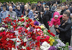 May 9, 2017 - Kiev, Ukraine - People lay flowers during Victory Day celebrations in front of the Tomb of the Unknown Soldier in Kiev, Ukraine, on 09 May 2017. People of former USSR countries celebrate the 72st anniversary of the victory over Nazi Germany in World War II (Credit Image: © Serg Glovny via ZUMA Wire)