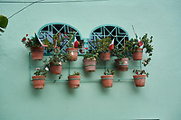 Mexican flags in flower pots outside windows in Ajijic to celebrate Mexican Independence day  (September 16)