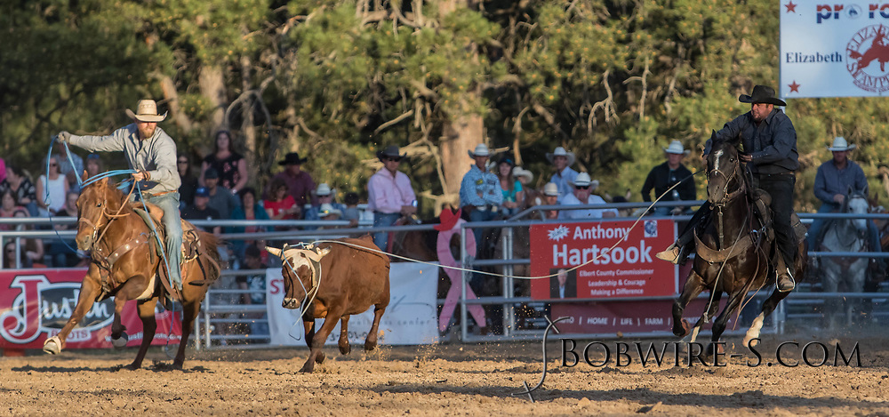 Header Jesse Sheffield and heeler Derek Younger make their team roping run during the second performance of the Elizabeth Stampede on Saturday, June 2, 2018.