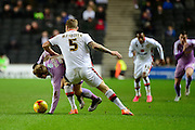 MK Dons defender Kyle McFadzean tussles with Readings Matej Vydra during the Sky Bet Championship match between Milton Keynes Dons and Reading at stadium:mk, Milton Keynes, England on 16 January 2016. Photo by Dennis Goodwin.