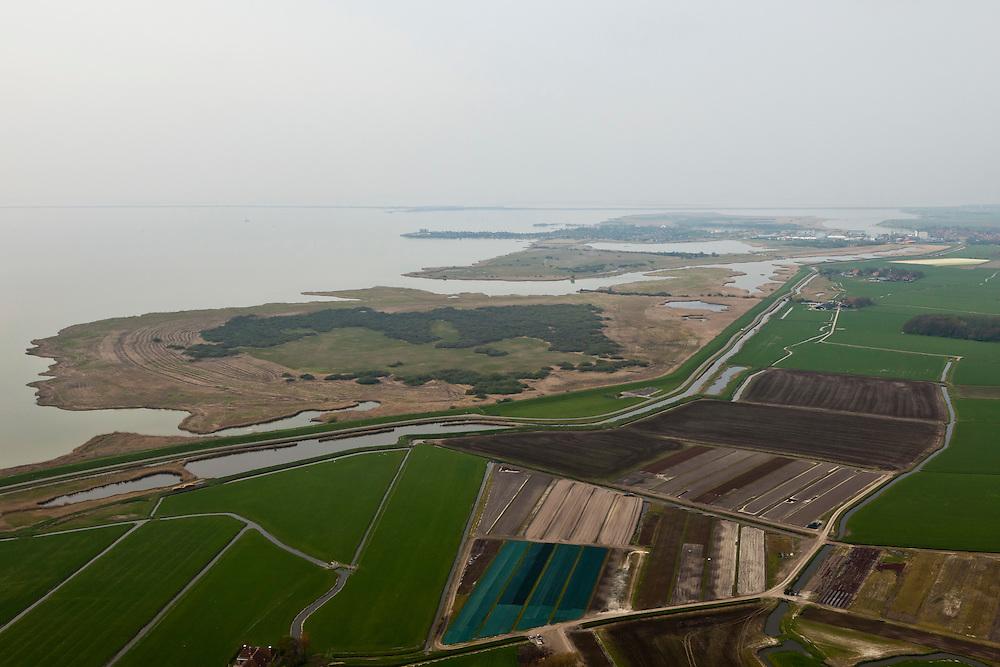 Nederland, Friesland, gemeente Wonseradeel, 28-04-2010; Makkumerwaard, bestaande Makkumer zuidwaard en Makkumer noordwaard (boven in beeld), gezien naar de Afsluitdijk..luchtfoto (toeslag), aerial photo (additional fee required).foto/photo Siebe Swart