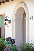 Mediterranean Style Smooth Stone Arched Front Entryway