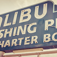 Malibu Pier sign retro panorama photo. The famous Malibu Sport Fishing Pier sign is along Pacific Coast Highway in Malibu California in the United States.