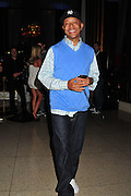 Music mogul Russel Simmons is all smiles after recieving a 1.5 million dollar donation to Hati at his celebrity poker tournament at the Eden Rock hotel in Miami Super Bowl Party Friday night Feb 5,2010. Photo©Suzi Altman/SuziSnaps