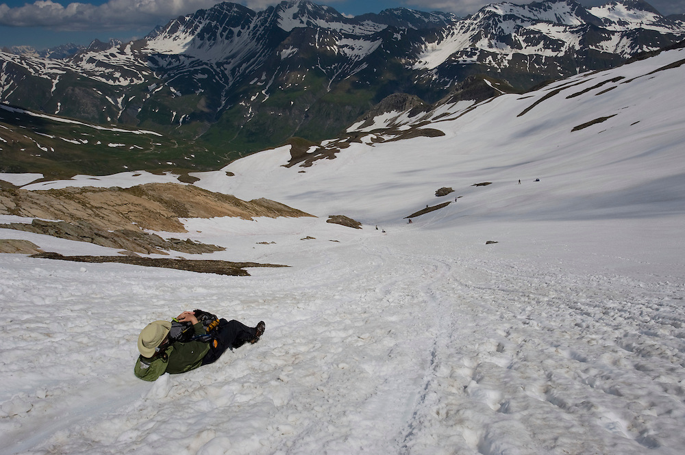 We had just finished crossing a ridge and were going down this snowfield in southeastern France.  My good buddy Dan put on his nylon pants and jacket and slid down it with a big grin on his face!
