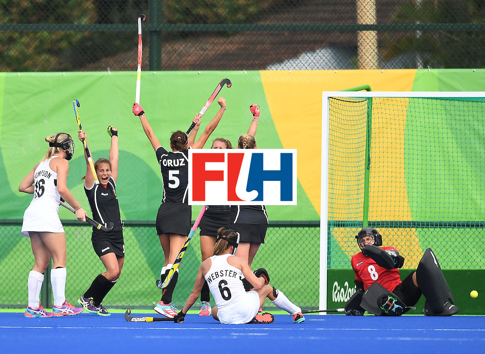 Germany's Nike Lorenz (4L) celebrates with teammates after scoring a goal during the women's field hockey New Zealand vs Germany match of the Rio 2016 Olympics Games at the Olympic Hockey Centre in Rio de Janeiro on August, 8 2016. / AFP / MANAN VATSYAYANA        (Photo credit should read MANAN VATSYAYANA/AFP/Getty Images)