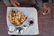 Truck dirver's breakfast. Cheese with herbs (otlu peyniri), pide bread, tea. Van, Turkey