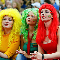 08 August 2012: Three fans are seen court side during Team Russia vs Team Lithuania, during the men's basketball quarter-finals, at the 02 Arena, in London, Great Britain.