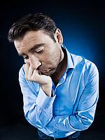 caucasian man unshaven portrait sulk tired isolated studio on black background