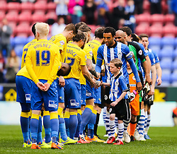 Wigan Athletic & Derby County players shake hands before kick off - Photo mandatory by-line: Matt McNulty/JMP - Mobile: 07966 386802 - 06/04/2015 - SPORT - Football - Wigan - DW Stadium - Wigan Athletic v Derby County - SkyBet Championship