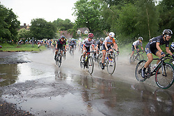 Ashleigh Moolmann-Pasio (RSA) of Cervélo-Bigla Cycling Team rides through flooded road section during the Aviva Women's Tour 2016 - Stage 2. A 140.8 km road race from Atherstone to Stratford upon Avon, UK on June 16th 2016.