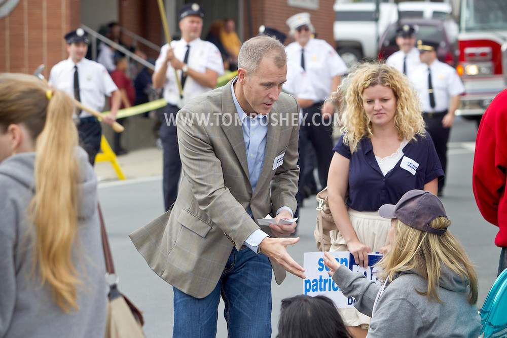 Middletown, New York - Democratic candidate Sean Patrick Maloney, who is running for Congress in the 18th Congressional District, shakes hands with people watching the Middletown Fire Department's annual Inspection Parade on Oct. 6, 2012. Maloney is a former adviser to President Bill Clinton.