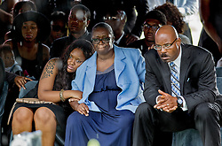 Husband Steve Hurd, on right, and family members watch as the casket is lowered and buried during funeral services for Cynthia Hurd, librarian and community leader, Saturday, June 27, 2015 at Emanuel AME Church. Paul Zoeller/Staff