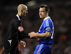 A dejected John Terry with referee Mike Riley during the Barclays Premier League match between Liverpool and Chelsea at Anfield on February 1, 2009 in Liverpool, England.