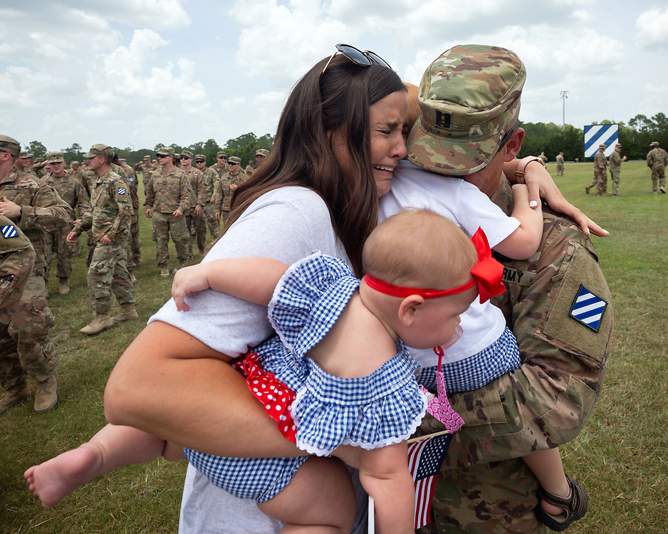 FORT STEWART, GA - JULY 17, 2019: Melissa Sherfesee, of Carrollton, Ga., along with her 7-month-old daughter Hensley Shefesee greet her husband Capt. Brice Sherfesee during a homecoming ceremony for the soldiers of the Macon-based 48th Infantry Brigade Combat Team Wednesday, July 17 2019 at Ft. Stewart, Ga. The unit finished a seven month deployment to Afghanistan in support of Operation Resolute Support. (AJC Photo/Stephen B. Morton)