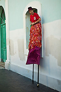 A stilt walker prepares to parade in the Festival of San Sebastian in San Juan, Puerto Rico.