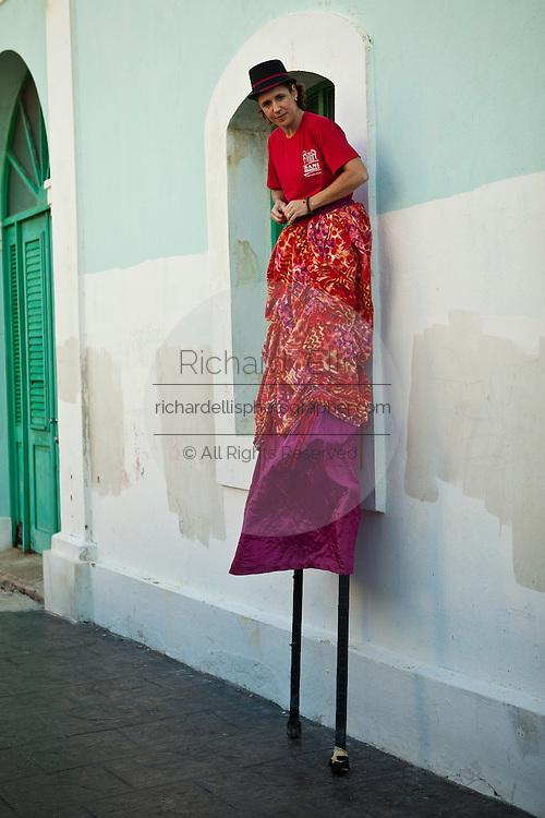 A stilt walker prepares to parade in the Festival of San Sebastian in San Juan, Puerto Rico.