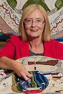 Tricia Marwick, Presiding Officer for the Scottish Parliament makes the final stitch for the Great Tapestry of Scotland project. Photographed at the Scottish Parliament in Edinburgh to mark the completion of the tapestry. www.scotlandstapestry.com<br /> <br /> pictures by Alex Hewitt