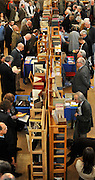 ©London News pictures...04/11/2010. Booklovers browse the main hall at the Chelsea Antiquarian Book Fair. The 20th annual Chelsea Antiquarian Book Fair takes place at Old Chelsea Town Hall in London. The fair is administered by the Antiquarian Booksellers' Association and features over 75 top dealers from across the United Kingdom. They are brought together under one roof to sell a huge variety of material - rare books, prints, atlases, maps, photographs, ephemera, letters and manuscripts - ranging in price from just a few pounds to many thousands.