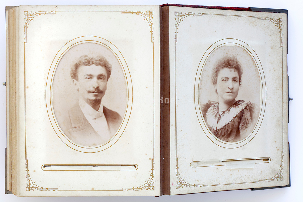 open vintage family photo album from late 1800s with portraits