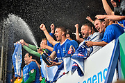 Portsmouth Players Celebrate winning League two on the final day of the season Portsmouth Midfielder, Carl Baker (7) opens the champagne during the EFL Sky Bet League 2 match between Portsmouth and Cheltenham Town at Fratton Park, Portsmouth, England on 6 May 2017. Photo by Adam Rivers.