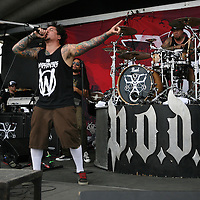 Sonny Sandoval of the band POD sings onstage at the Rockstar Energy Drink Festival at the 1-800-Ask-Gary amphitheater in Tampa, Florida on Thursday, September 13, 2012. (AP Photo/Alex Menendez)