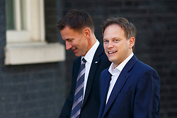 © Licensed to London News Pictures. 01/07/2014. LONDON, UK. Health Secretary Jeremy Hunt and Conservative Chairman Grant Shapps attending to a cabinet meeting in Downing Street on Tuesday, 1 July 2014. Photo credit: Tolga Akmen/LNP