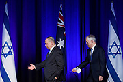 Israeli Prime Minister Benjamin Netanyahu (left) and Australian Prime Minister Malcolm Turnbull take to the stage to answer questions at a luncheon at the International Convention Centre in Sydney, Australia.