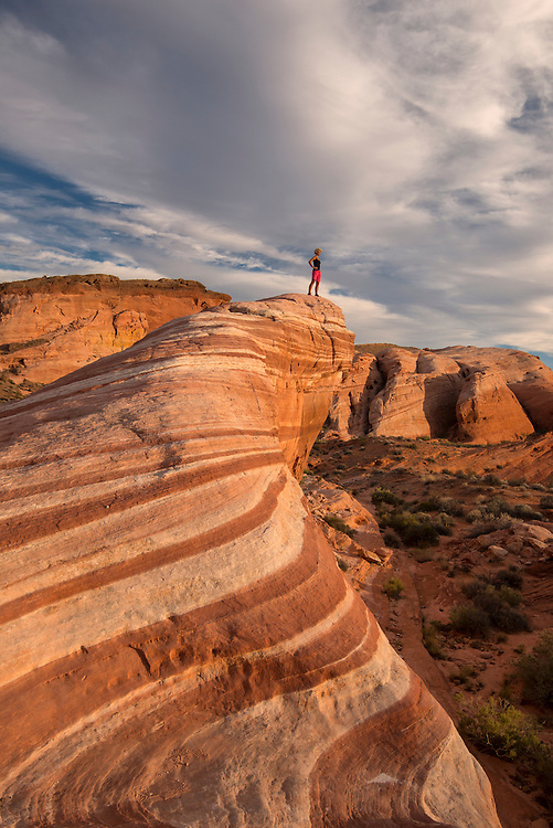 USA, Southwest,Nevada, Valley of Fire, State Park, Fire Wave, woman standing on sandstone MR 0530