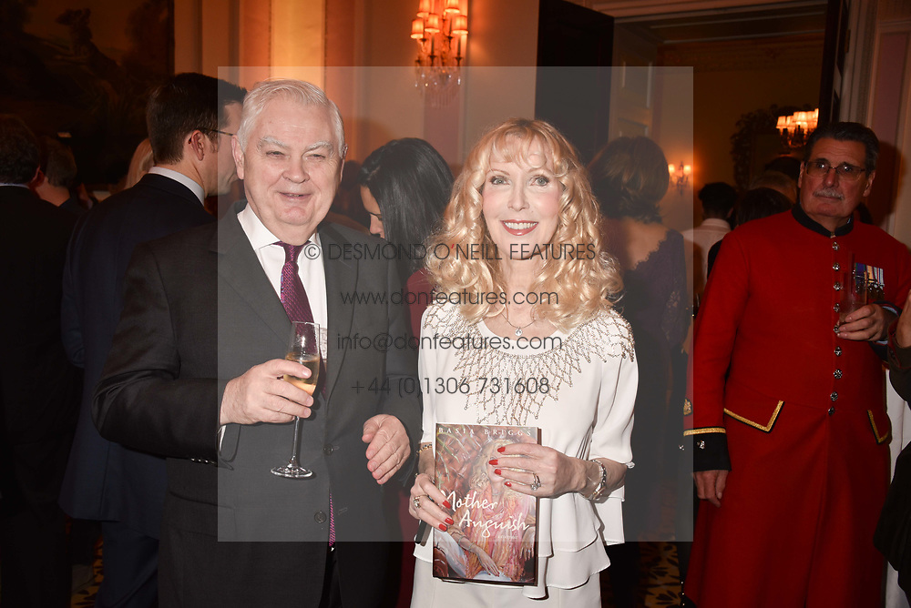 Lord Lamont and Basia Briggs at a reception to celebrate the publication on 'Mother Anguish' by Basia Briggs held in The Music Room, The Ritz Hotel, 150 Piccadilly, London, England. 04 December 2017.