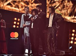 The 1975 with the award for Best British Group on stage at the BRIT Awards 2017, held at The O2 Arena, in London.<br />