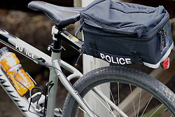 Police use bicycles with saddle bag attached to move around in areas congested by traffic where a police car would simply get blocked in.