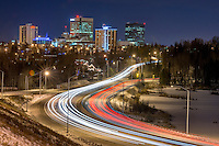Traffic moves along Minnesota Drive close to downtown Anchorage, Alaska.