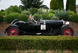 © Licensed to London News Pictures. 13/07/2015. Epsom, UK. STUART ANDERSON and RICHARD LAMBLEY ready their 1938 Bentley at the start line in front of Woodcote Park. The start of The Royal Automobile Club 1000 Mile Trial 2015 at Woodcote Park in Epsom, Surrey. The event, which starts and finishes at Woodcote Park, takes a fleet of over 40 classic cars from around the world, through a 1000 mile trial around the UK.  Photo credit: Ben Cawthra/LNP