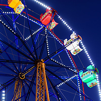 Newport Beach Ferris Wheel photo at night. The Balboa Fun Zone Ferris Wheel is a popular attraction in  Southern California in the United States of America. Photo is high resolution. Copyright ⓒ 2017 Paul Velgos with All Rights Reserved.