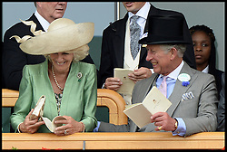 Prince Charles and The Duchess of Cornwall look at horses in the parade ring from the royal box at Royal Ascot 2013<br /> Ascot, United Kingdom<br /> Wednesday, 19th June 2013<br /> Picture by Andrew Parsons / i-Images
