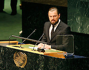 Leonardo DiCaprio addresses the Climate Change Summit at the United Nations in New York, Tuesday, Sept. 23, 2014. (Photo/Stuart Ramson/United Nations Foundation)